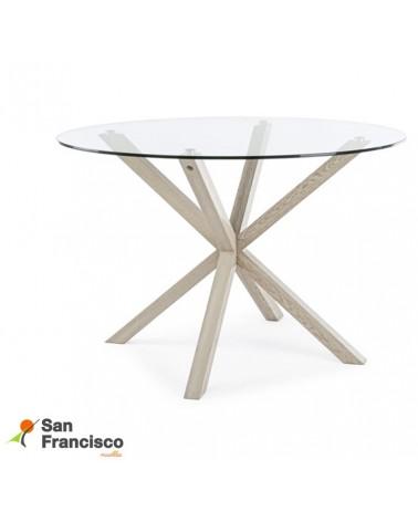 Mesa comedor diseño moderno tapa redonda en cristal templado y patas metálicas efecto madera.